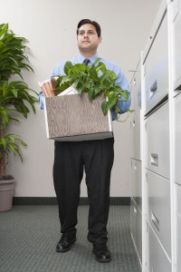 Businessman moving items in office