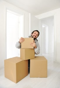 Man with boxes moving in new house